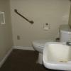 Restroom with commode and sink